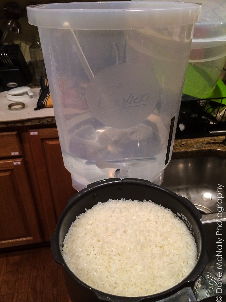Okay, I've cooked the rice and sanitized the gear. I happen to have a brew kit with a 20-liter fermenting vessel. This thing is huge! I added the 8 liters of water first, then the rice, then 1 cup of the Korean wheat enzyme (nooruk).