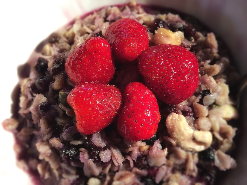 Breakfast: Oatmeal with nuts, seeds, blueberries and homegrown strawberries!